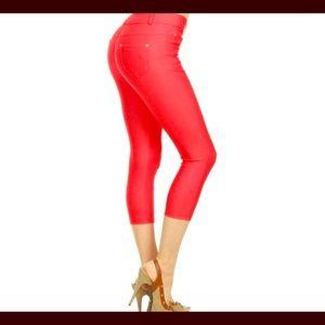Red Capri pants.